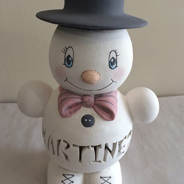 Custom carved snowman pottery with top hat